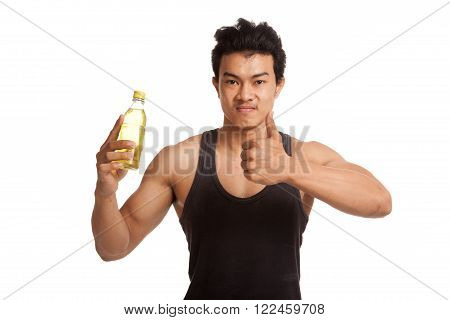 Muscular Asian Man Thumbs Up With Electrolyte Drink