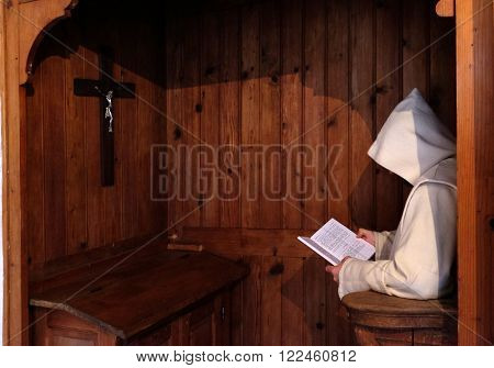 PLETERJE, SLOVENIA - NOVEMBER 06: Carthusians monks praying in his room, Carthusian monastery in Pleterje, Slovenia on November 06, 2015.