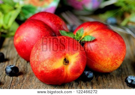 Juicy ripe fruit colorful summer peach nectarine
