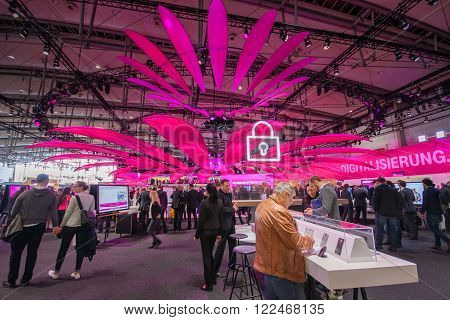 HANNOVER, GERMANY - MARCH 14, 2016: Booth of Deutsche Telekom company at CeBIT information technology trade show in Hannover, Germany on March 14, 2016.