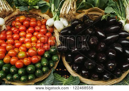 Fresh Red Tomatoes, Zuccini Eggplants In Baskets Outside Market Sale