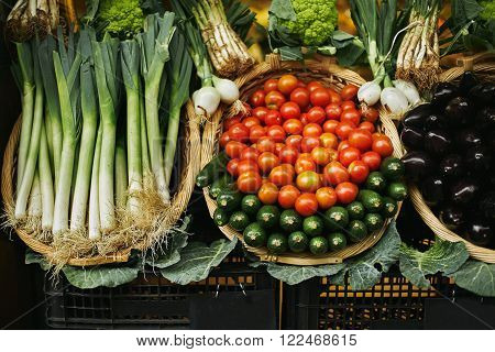 Tomatoes, Leeks And Zuccini Presented In Basket For Sale Market