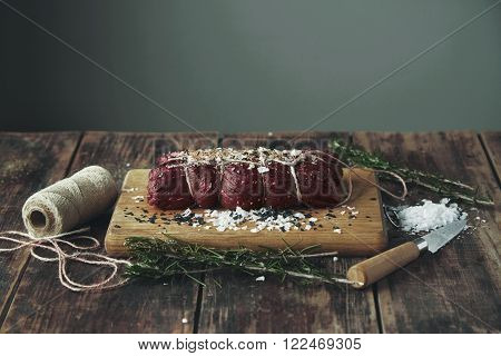 Tied Piece Of Meat To Smoke Salted Spiced Wooden Table