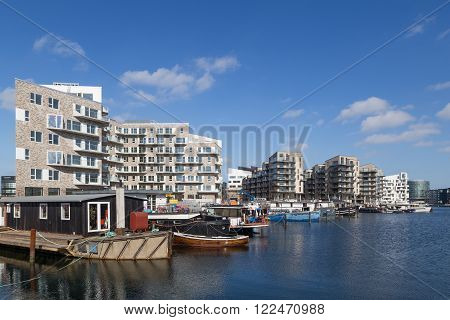 Copenhagen, Denmark - March 17, 2016: Newly built modern appartments and houseboats.