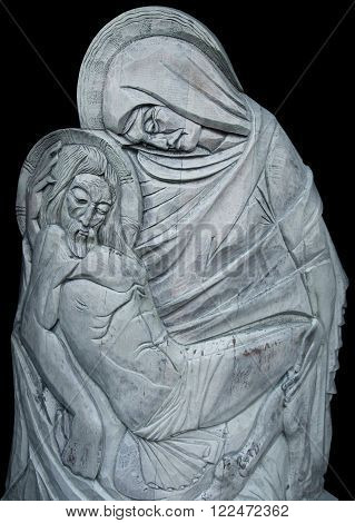 silver statue of Virgin Mary with Jesus Christ in her arms (Crucifixion pain death resurrection)
