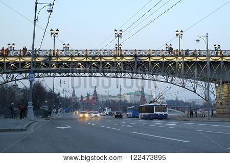 RUSSIA, MOSCOW - 12 APR, 2015: Car traffic under the Patriarshy bridge near Grand Kremlin Palace.