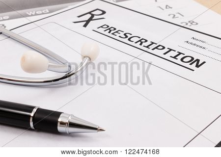 Closeup Of Red Stethoscope And Pen On A Rx Prescription.