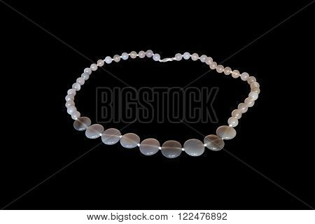 Beads from natural agate on a white background