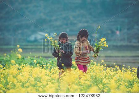 HAGIANG, VIETNAM, FEBRUARY 27, 2016 : Unidentified ethnic minority kids in Hagiang, Vietnam. Hagiang is a northernmost province in Vietnam