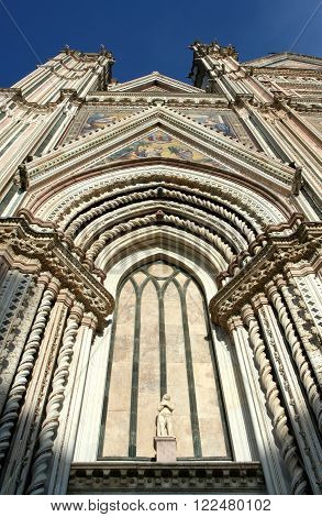 Cathedral of Orvieto in Umbria in Italy. Detail of the facade in the Gothic style