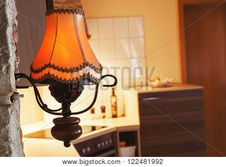 orange lamp with lampshade on a kitchen