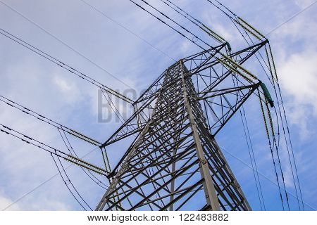 Electric power tower in the blue sky