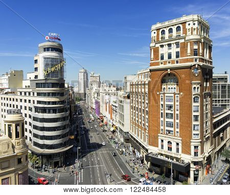 MADRID, SPAIN - AUGUST 28, 2015: Madrid citiscape, with the Gran Via street, the Capitol and the Palacio de la Prensa (Palace of the Press) in Madrid, Spain on Aug 28, 2015