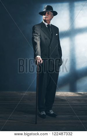 Vintage 1940 Senior Businessman Standing With Cane In Room.