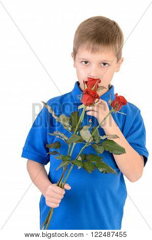 Young boy smelling a rose isolated on white background