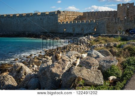 Place in the port of Rhodes where stood the Colossus of Rhodes Greece