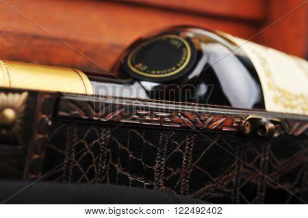 view of Cognac bottle in wooden case background