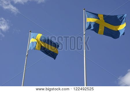 Two Swedish National flag with blue sky