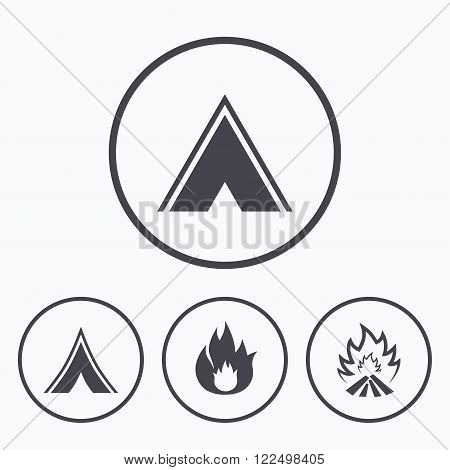 Tourist camping tent icons. Fire flame sign symbols. Icons in circles.