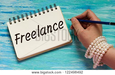 freelance Inspirational quote women's hand lettering for posters writing notebook note turquoise wooden background Word refer news current affairs special occasions business planning