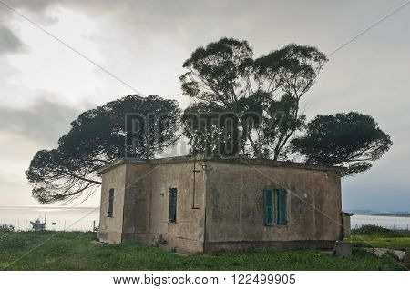 Old house at sea coast, Nora archeological site, island of Sardinia, Italy