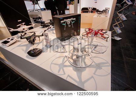 HANNOVER GERMANY - MARCH 14 2016: Multiple drones displayed at CeBIT information technology trade show in Hannover Germany on March 14 2016.