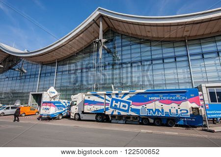 HANNOVER GERMANY - MARCH 14 2016: TVN truck with video and tv studio at CeBIT information technology trade show in Hannover Germany on March 14 2016.