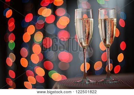 Pair glass of champagne on table. New year or wedding celebration concept theme.