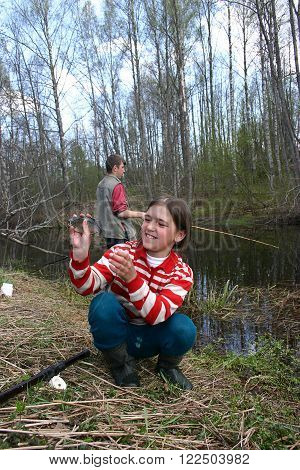 Tver, Russia - May 6 2006: Countryside teen girl Tanya Shchegolev 11 years old white bream caught while fishing in the village river