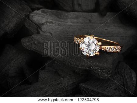 jewelry ring witht big diamond on dark coal background