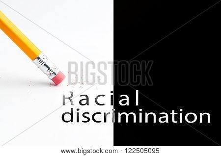 Closeup of pencil eraser and black racial discrimination text. Racial discrimination. Pencil with eraser.