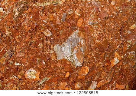 Brown and red rocky soil nature background.