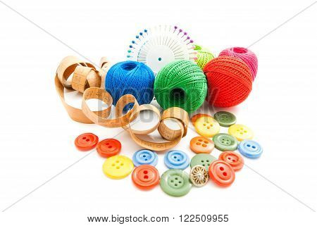 Pins, Meter, Buttons And Thread On White