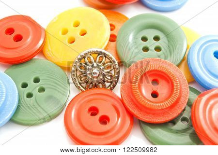 Different Plastic Buttons On White