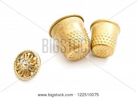 Plastic Button And Thimbles On White