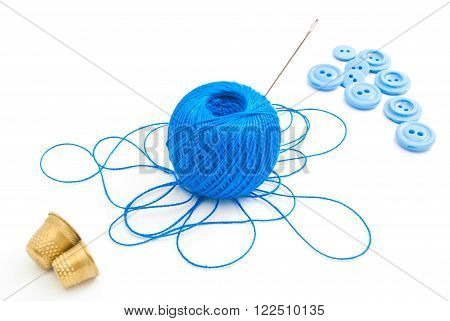 Spool Of Thread, Thimbles And Blue Buttons
