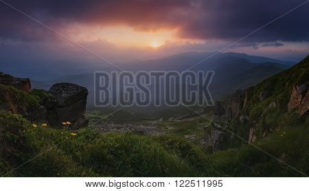Carpathian Mountains. Mount Pop Ivan. Panorama. The sun was setting behind the mountains.