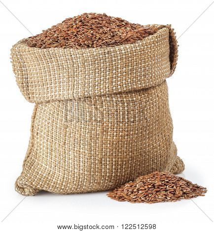full burlap bag with flax seed and heap of flax seed isolated on white background