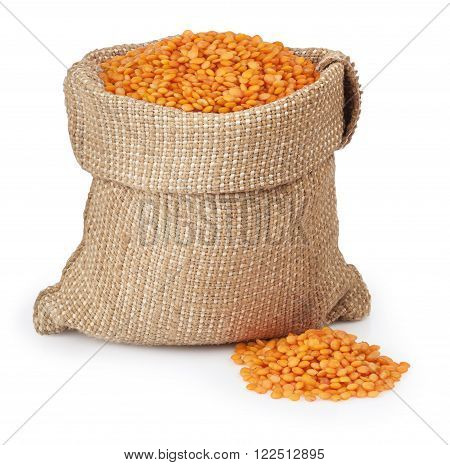 red lentils in burlap bag and heap of red lentils isolated on white background