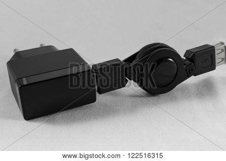 Black Phone Charger and USB cable on white background close-up