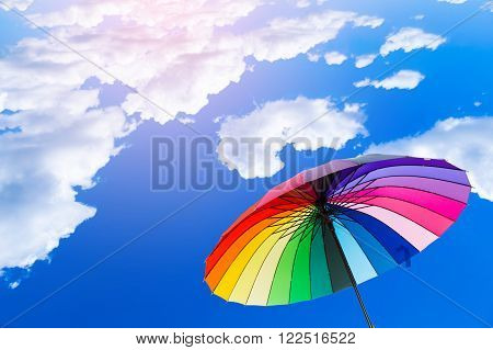 Rainbow umbrella on a beautiful blue sky afternoon.