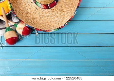 Mexican sombrero and traditional serape blanket background