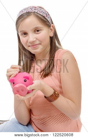 a preteen with a piggy bank, on white