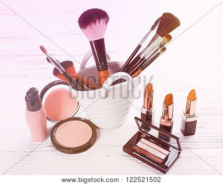 Cosmetics on light background