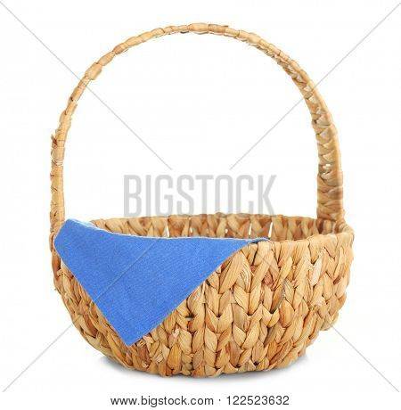 Wicker basket with blue napkin isolated on white