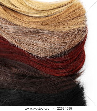 Varicolored strands of hair, isolated on white