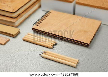 Office set with notebooks and stationery on grey background