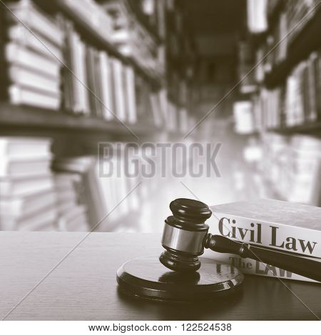 Wooden judges gavel on table in library