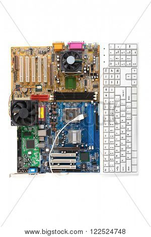 Computer motherboards with keyboard and fans, isolated on white
