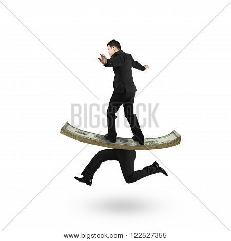 Man balancing on running money with human legs isolated on white background.